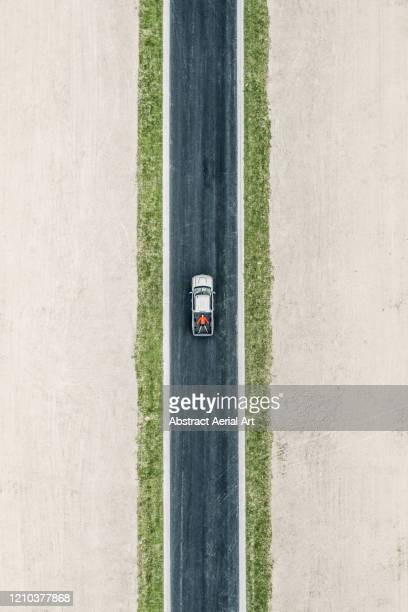 person lying down in the back of a pick-up truck photographed from above, florida, united states of america - straight stock pictures, royalty-free photos & images