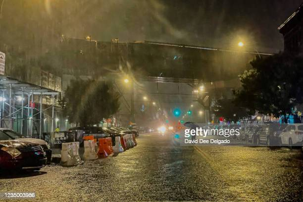 Person makes their way in rainfall from the remnants of Hurricane Ida on September 1 in the Bronx borough of New York City. The once category 4...