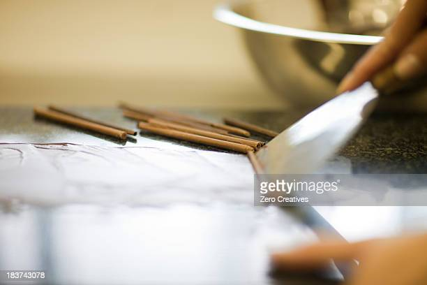 Person making chocolate rolls
