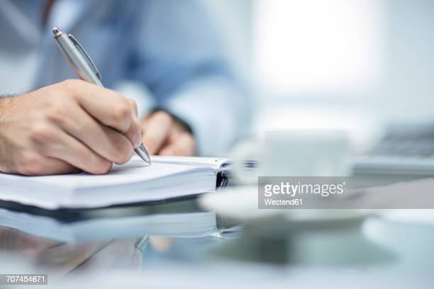 Person making notes in a dairy