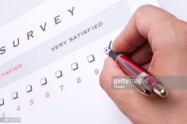 Person marking very satisfied on a survey