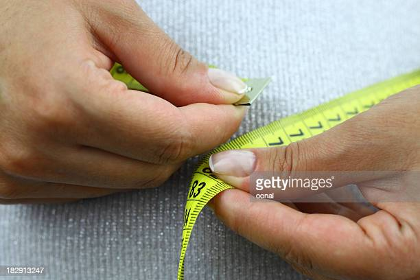 person measuring their waste line - fat belly girl stock photos and pictures