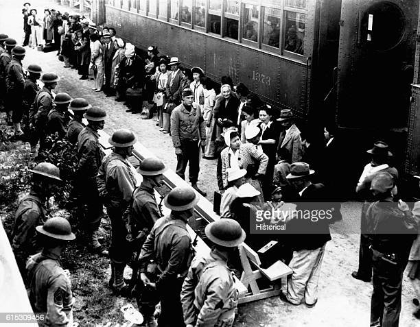 Person of Japanese ancestry arrive at the Santa Anita Assembly Center from San Pedro Evacuees lived at this center at the former Santa Anita race...