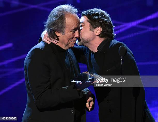 Person of the Year honoree Joan Manuel Serrat and recording artist Joaquin Sabina speak onstage during the 15th annual Latin GRAMMY Awards at the MGM...