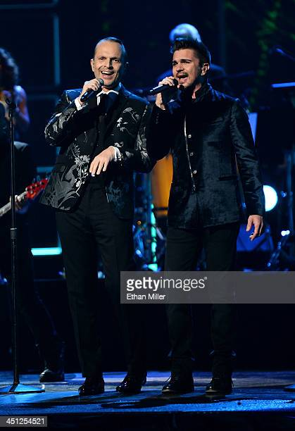 Person of the Year honoree Miguel Bose and singer Juanes perform onstage during the 14th Annual Latin GRAMMY Awards held at the Mandalay Bay Events...