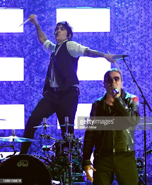 Person of the Year honorees Alex Gonzalez and Fher Olvera of Mana perform onstage during the 19th annual Latin GRAMMY Awards at MGM Grand Garden...