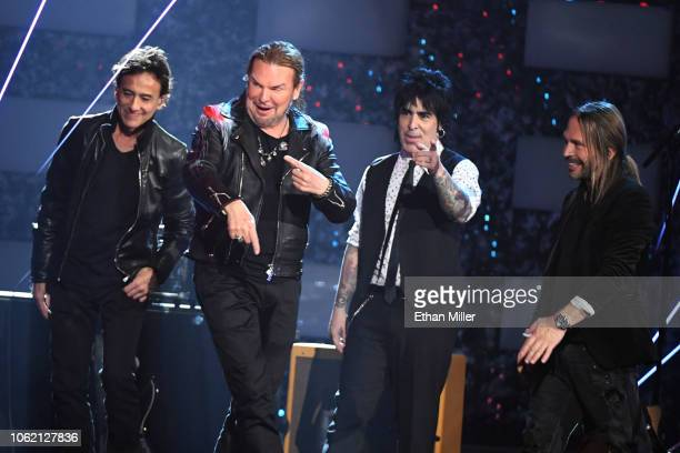 Person of the Year honorees Juan Calleros Fher Olvera Alex Gonzalez and Sergio Vallin of Mana speak onstage during the 19th annual Latin GRAMMY...
