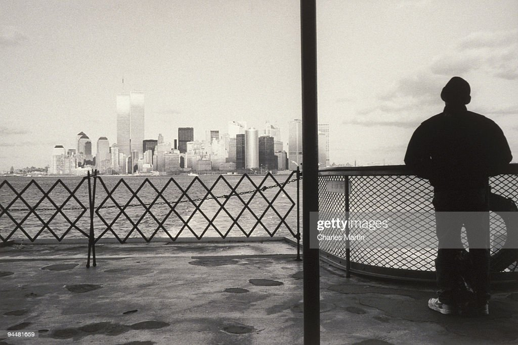 Person on ferry boat looking out at New York City : Stock Photo