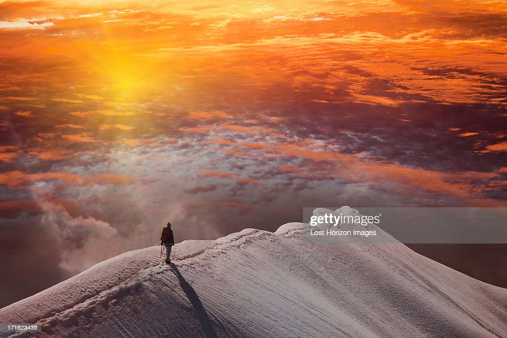 Person on mountain at sunset, Piz Palu, St Moritz, Canton Graubunden, Switzerland : Stock Photo