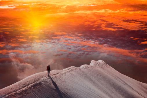 Person on mountain at sunset, Piz Palu, St Moritz, Canton Graubunden, Switzerland - gettyimageskorea