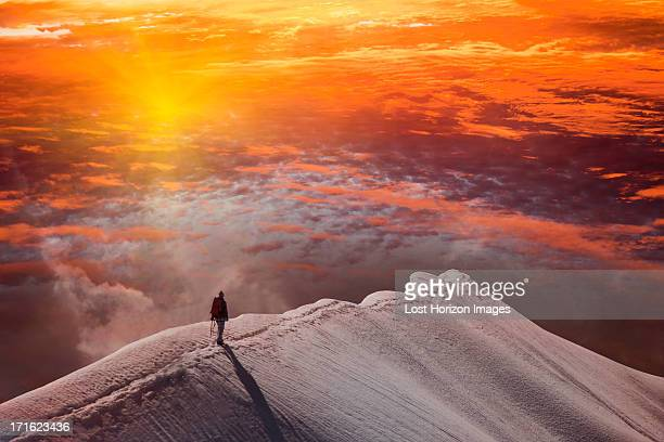 Person on mountain at sunset, Piz Palu, St Moritz, Canton Graubunden, Switzerland