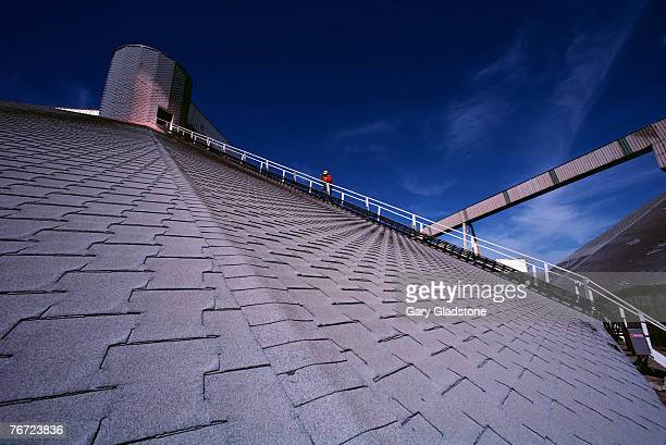 person on rooftop stairway - potash stock pictures, royalty-free photos & images