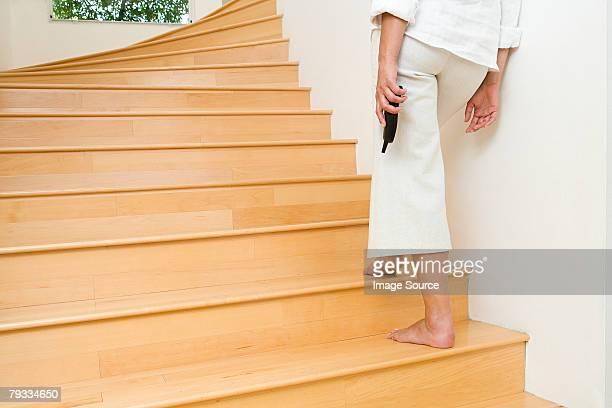 Person auf Treppe