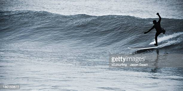 person on surfboard - s0ulsurfing stock pictures, royalty-free photos & images