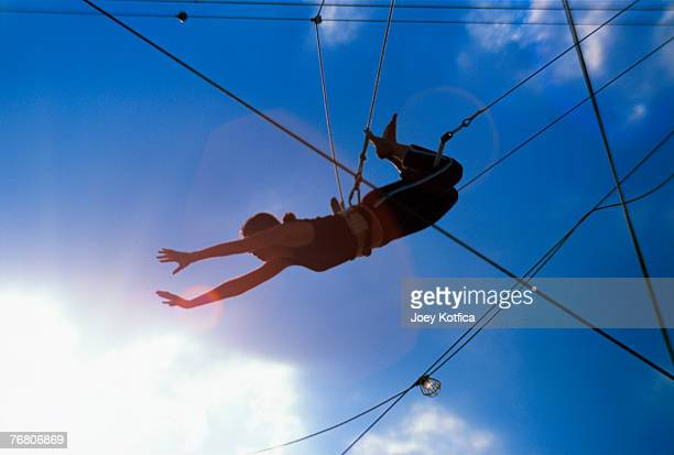 person on trapeze - trapeze artist stock photos and pictures
