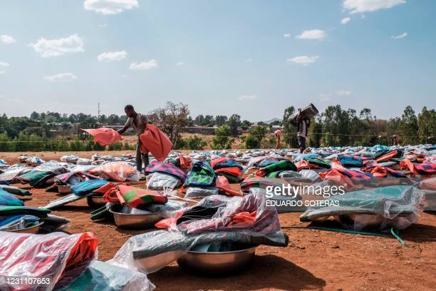 Person organize piles of items during an items distribution by an international non-governmental organization for Internally Displaced People fleeing...