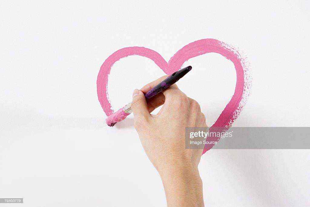 Person malen ein Herz : Stock-Foto