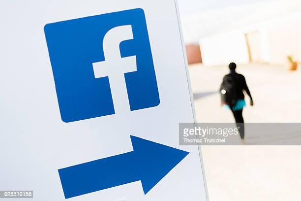 A person passes a logo of the social media platform Facebook on November 15 2016 in Marrakesch Morocco