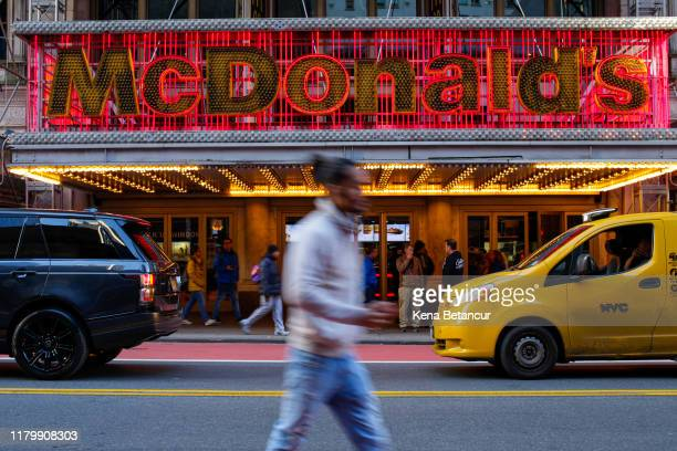 A person passes a McDonald's restaurant in Times Square following the firing of their CEO Steve Easterbrook on November 4 2019 in New York City...