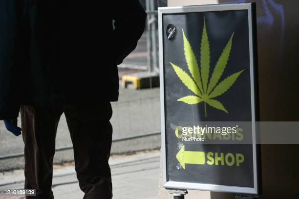 Person passes by a sign Cannabis Shop in Krakow. This evening, Prime Minister Mateusz Morawiecki presented the 'New Normality' plan that consist of...