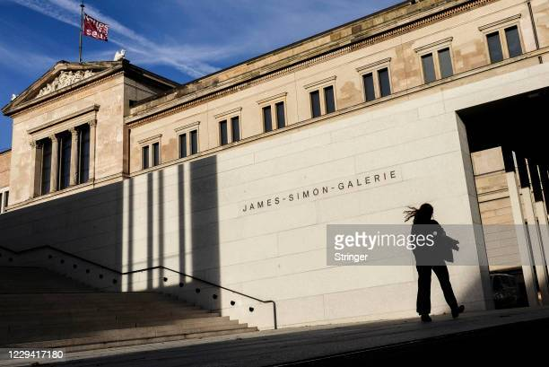 Person passes by the James Simon Gallery on the first day of a four-week semi-lockdown during the second wave of the coronavirus pandemic on November...