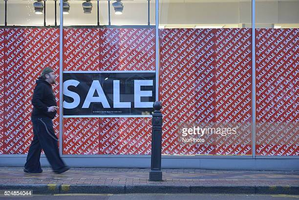 A person passing a sale sign in Stockport England United Kingdom on Tuesday 5th January 2015 Between December 28th 2015 and January 1st 2016 footfall...