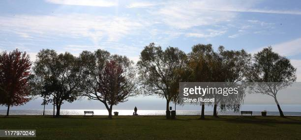 TORONTO ON OCTOBER 24 A person pauses from their walk on the boardwalk to look out on Lake Ontario at the Beaches in Toronto October 24 2019