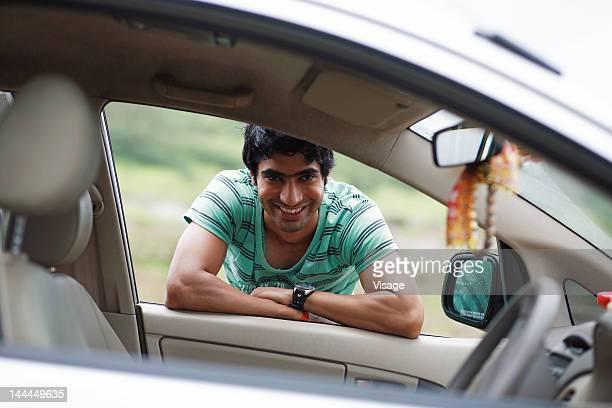 A person peeping through a car window