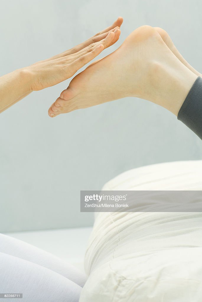 Person performing Reiki foot massage, cropped view : Stockfoto