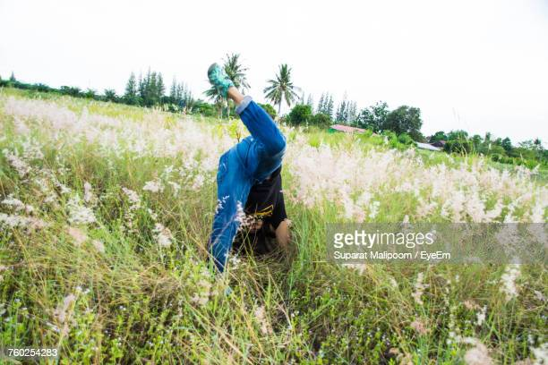 Person Performing Stunt On Grassy Field