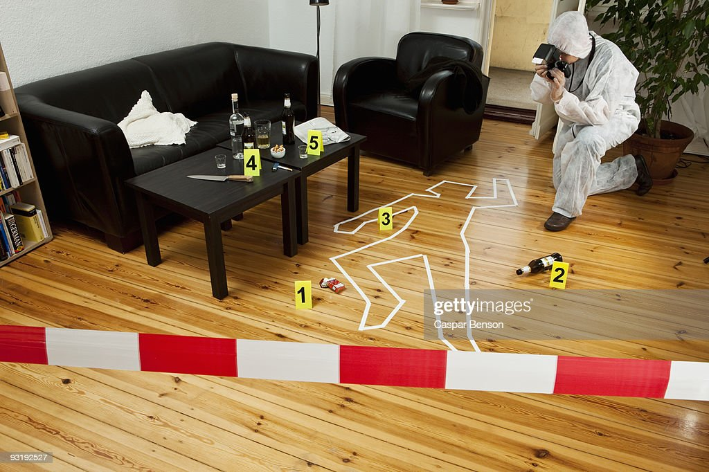 A person photographing a crime scene : Stock Photo