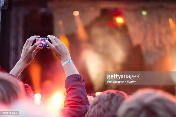 Person Photographing Music Concert