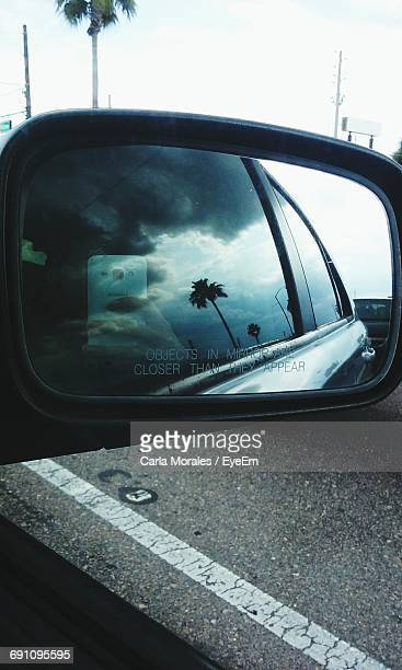 person photographing reflecting on car side-view mirror - kissimmee stock pictures, royalty-free photos & images