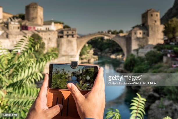 Person photographing view with smartphone, Stari Most, Mostar, Federation of Bosnia and Herzegovina, Bosnia and Herzegovina, Europe