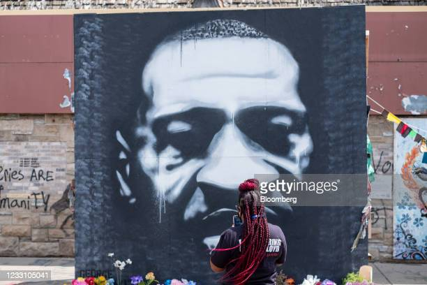 Person photographs a mural depicting George Floyd during a 'Rise and Remember' event at George Floyd Square in Minneapolis, Minnesota, U.S., on...