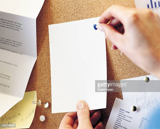 Person pining up a blank card