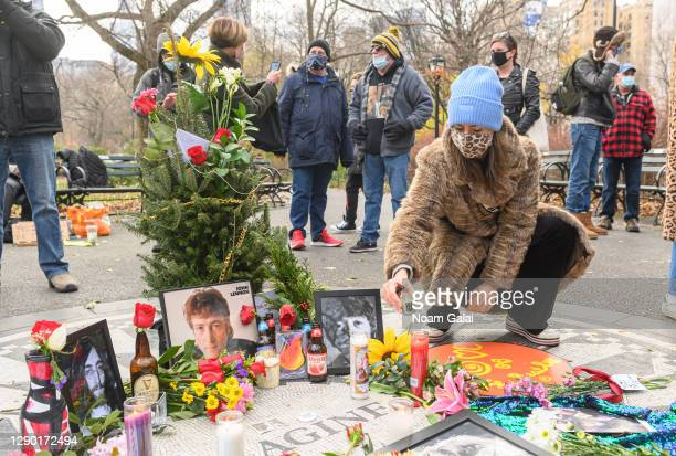 Person places a memorial candle for John Lennon on the 40th anniversary of his death at Strawberry Fields in Central Park on December 08, 2020 in New...
