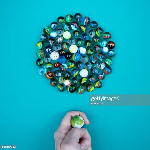 Person playing a game of marbles