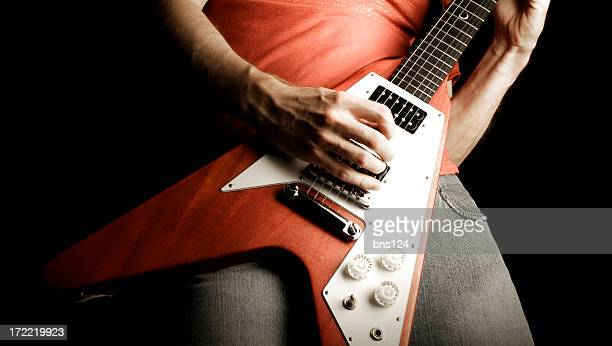 a person playing a rock and roll guitar - modern rock stock pictures, royalty-free photos & images