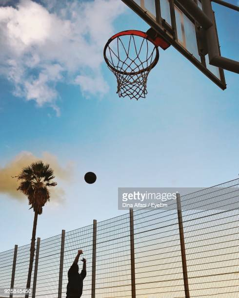 Person Playing Basketball Against Sky