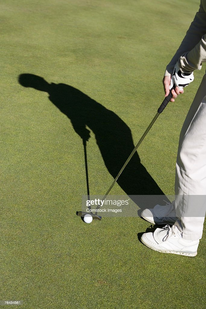 Person playing golf : Stockfoto