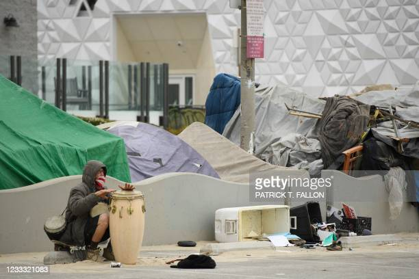 Person plays a musical instrument near an encampment at Venice Beach on June 7, 2021 in Los Angeles, California. - Mayoral candidate Joe Buscaino...