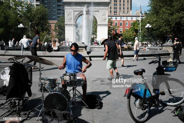 Person plays drums in Manhattan's Washington Square Park on June 10, 2021 in New York City. As New York City emerges from the Covid-19 pandemic,...