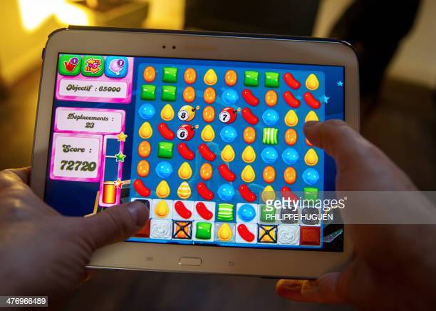 A person plays on his tablet with Candy Crush Saga games developed by British King Digital Entertainment on March 6 in Lille northern France The game...