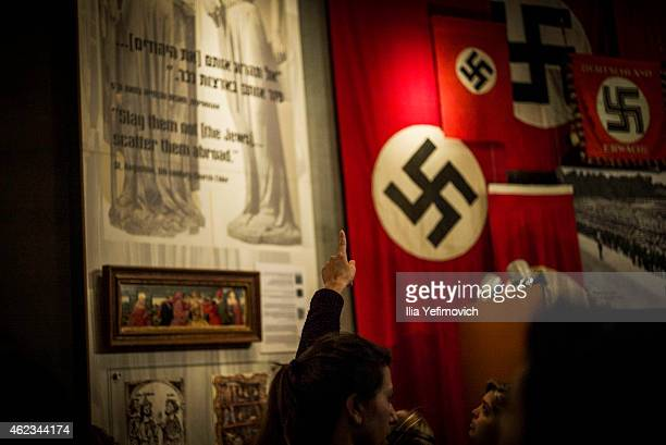 A person points to a display as they visit the Yad Vashem museum to see the exhibition and commemorate International Holocaust day on January 27 2015...
