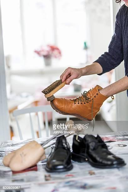 Person polishing shoes