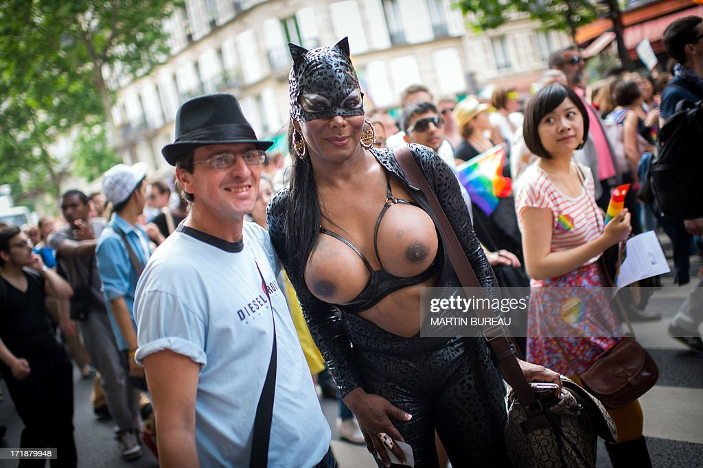 A person poses during the homosexual, lesbian, bisexual and transgender (HLBT) visibility march, the Gay Pride, on June 29, 2013 in Paris, exactly one month to the day since France celebrated its f...