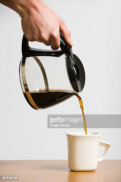 person pouring coffee - dump stock photos and pictures