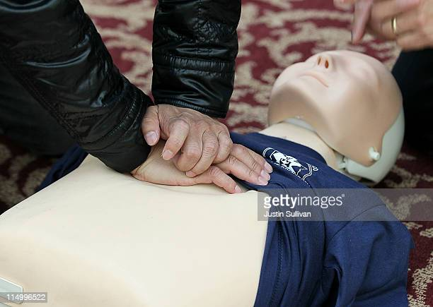 A person practices CPR compressions on a mannequin at San Francisco City Hall on June 1 2011 in San Francisco California The San Francisco Paramedic...