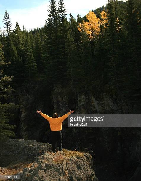 Person praising on a mountain.